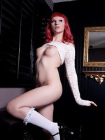 Redhead Bailey Jay posing in sexy white lace