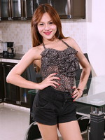 Stunning TS Gam stripping and posing in the kitchen