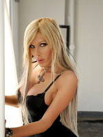 Kimber James black dress and heels