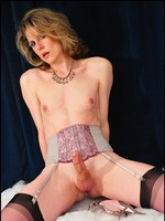Seductive mature shemale in sexy purple stockings.