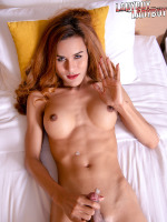 Feast your eyes on the beautiful Nuk. She is on the bed, oh so horny and ready to play! Watch Nuk jerking off her cock and delivers a nice load of cum!