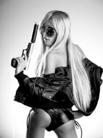 Kimber James has a gun bw