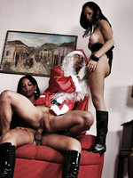 Two shemale dommes catch and abuse santa