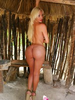 Busty Blond Tranny Ana Mancini gets naked outdoors in this awesome photoset