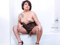 The beautiful Iya'lee is dressed in a see through black bikini and I assure you she's amazingly hot. She is pure arousal and underneath that bikini is a sexy set of nice tits and a juicy cock. Watch her working on her hard cock in the bathroom.