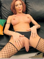 Breasty redhead shemale takes off clothes then masturbating on the couch