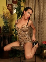 Beautiful transsexual Danika strips and poses
