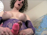 Transexual Delia plays with her shiny pink cock.