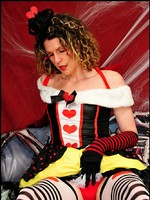 Tranny Delia as the Queen of Hearts stroking her royal sceptre.