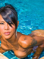 Mouth-watering ladyboy bronzing body by the pool