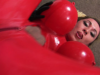 Sabrina spills her load on her shiny latex