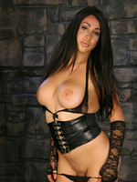 Busty Dior posing in the dungeon