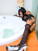 Shemale bunny shows off stiff cock and plugged butt