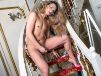 Rinka works the staircase in this set, stripping off her pantyhose before the dress, bra, and panties come off to reveal her flaccid cock.  It isn't long before her cock starts throbbing as hard as the resting bitch face she exudes.