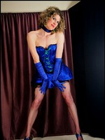 Costumed tranny masked in blue shows stiff cock & black nylons under black lace petticoat.