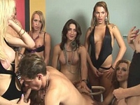Ten trannies take turns stick their cocks on a dude's ass until they blow their load