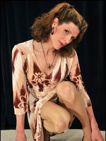 Big-cock tgirl in nude control-top pantyhose and femme wrap dress.