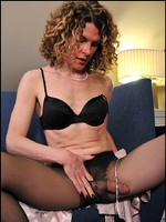Hard tranny with huge cock creams her fancy black pantyhose.