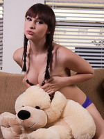 Bailey Jay TS sweetheart Bailey Jay playing with a stuffed dog