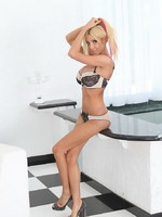 Big titted hottie Kimber James stripping and posing