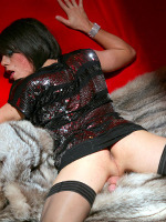Gorgeous Zoe posing on a bright red sofa and fur coat