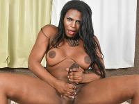 Sexy Perola Negra is a hot Black tgirl with a curvy body, big boobs, a juicy ass and a huge hard cock! Watch this sexy Grooby girl jacking her big cock!
