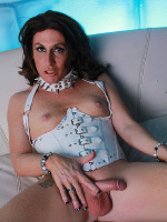 Horny Reese spreads & jerks in corset