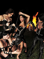 4 Shemale dominas roast a slave out by the fire