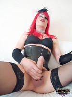 Gorgeous red head Zoe plays with her huge cock