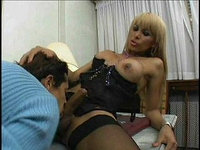 Busty blonde shemale gets sucked by a young guy