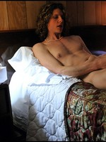 Tgirl in pleated skirt, pearls and white panties in no tell motel.