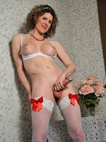 Delia in white thigh highs and lace panties.
