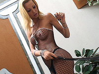 Hot Blonde Shemale Strips off Fishnet Bodysuit and Jerks