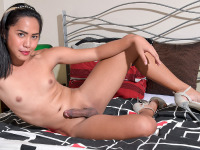 Jham is here and she is the kind of ladyboy that you won't soon forget! This stunning doll has a nice cock that is near perfection, has cute ass and natural tits that's waiting for you. Watch Jham as she turns on her sexual charm and you'll see why she is one of the hottest.