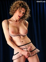 Tranny tease Delia's sweet stiff femrod in see-through pink lingerie.