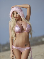 Kimber James Big titted sweetie Kimber posing at the beach