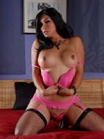 Hot TS Vaniity posing in sexy black stockings and pink lingerie