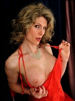 Tranny cougar Delia in red satin gown and animal print thong.