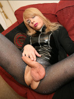 Hot TV Zoe tears her nylons and shows big cock